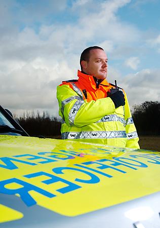 Traffic Officer using mobile radio comms