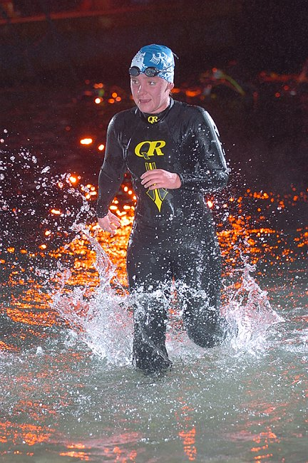 Competitive Open Water Swimming at Night.