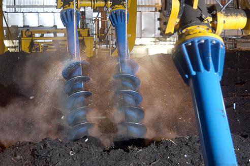 Biomax screws rotating composting material