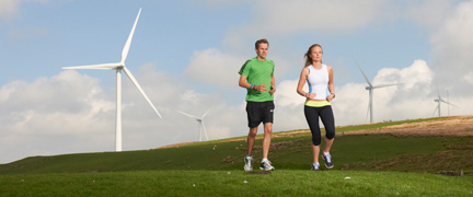 Runners enjoying the footpath across a wind farm