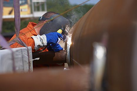 Cathodic protection. Welding sacraficial magnesium anodes to a support leg